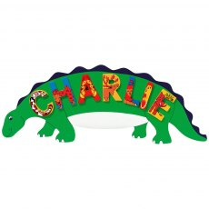 Green dinosaur plaque