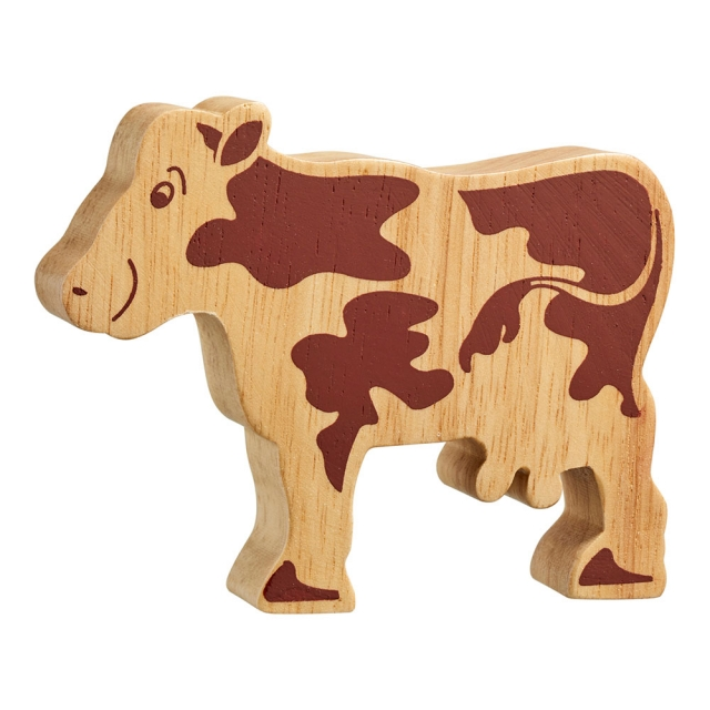 A chunky wooden standing cow toy figure in profile, plain with wood grain