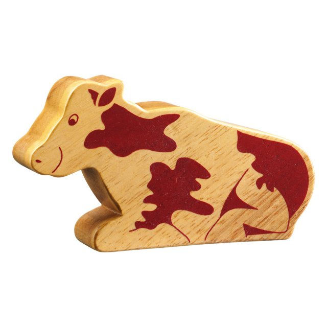 A chunky wooden sitting down cow toy figure in profile, plain with wood grain