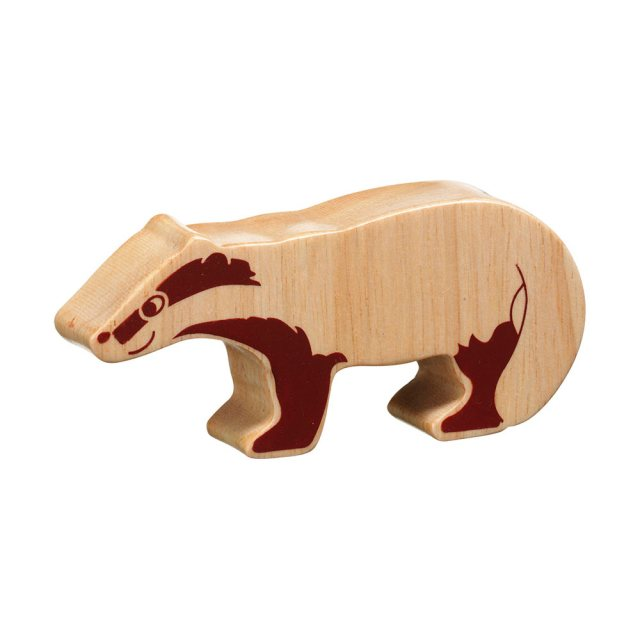 A chunky wooden badger toy figure in profile, plain with wood grain