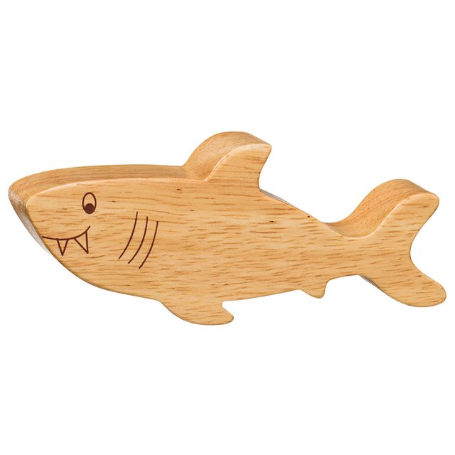 A chunky wooden shark toy figure in profile, plain with wood grain