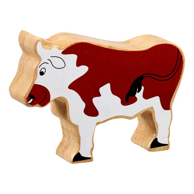 A chunky wooden brown bull toy figure in profile with a natural wood edge