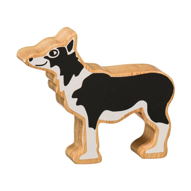 A chunky wooden black/white sheep dog toy figure in profile with a natural wood edge