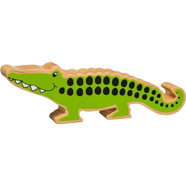 A chunky wooden green crocodile toy figure in profile with a natural wood edge