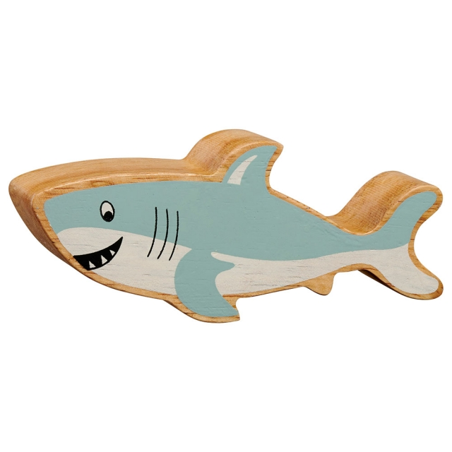A chunky wooden painted grey shark toy figure in profile with a natural wood edge