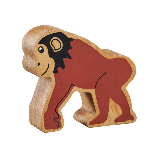 A chunky wooden painted brown chimpanzee toy figure in profile with a natural wood edge