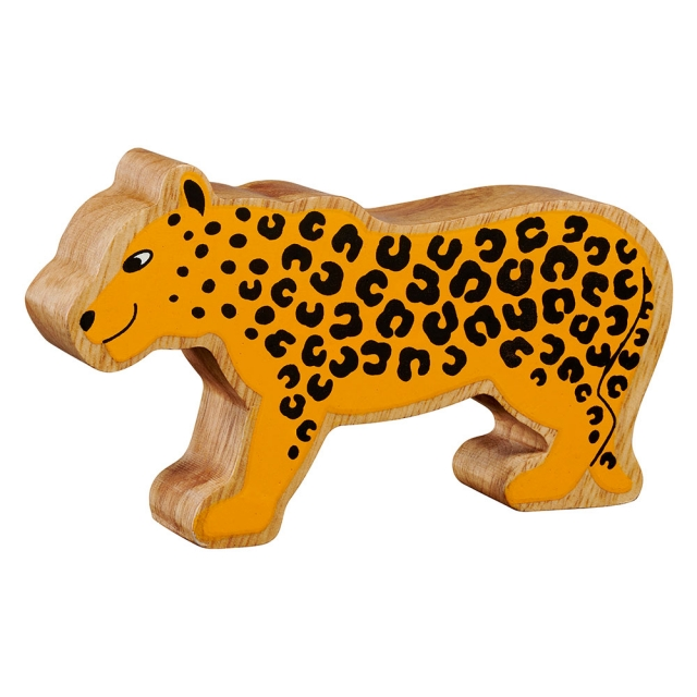 A chunky wooden painted yellow spotty leopard toy figure in profile with a natural wood edge