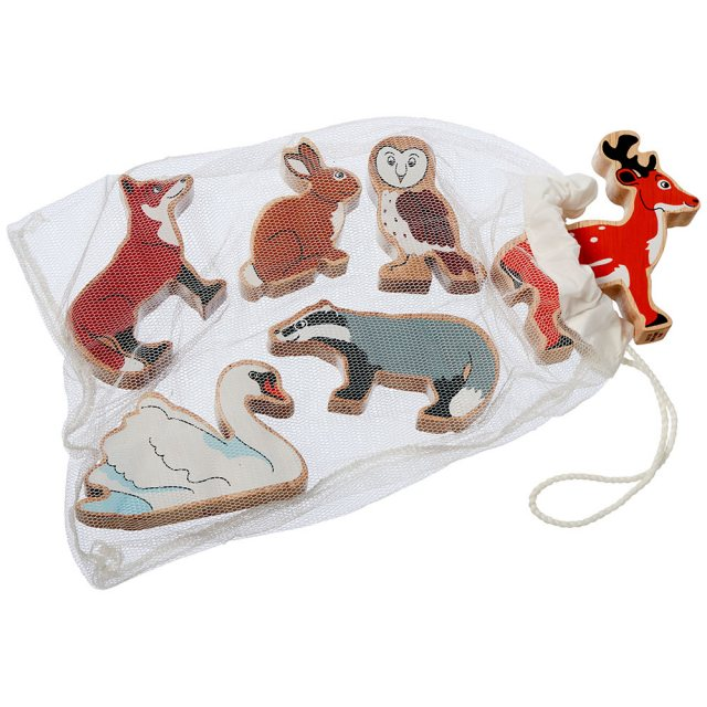 Set of six colourful wooden countryside animals including fox, owl and deer in a net bag