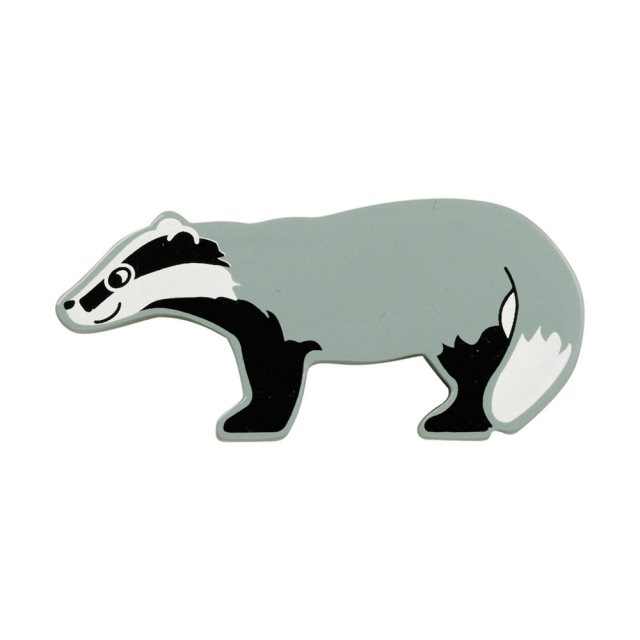 A grey, black and white badger wooden toy figure in profile