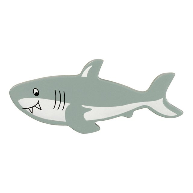 A grey and white shark wooden toy figure in profile
