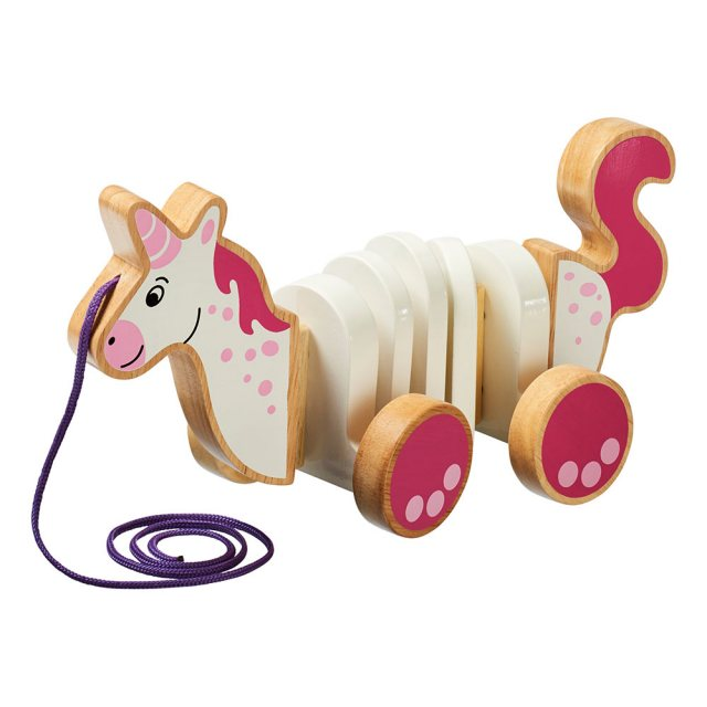 White and pink wooden unicorn pull along toy with four wheels and purple string