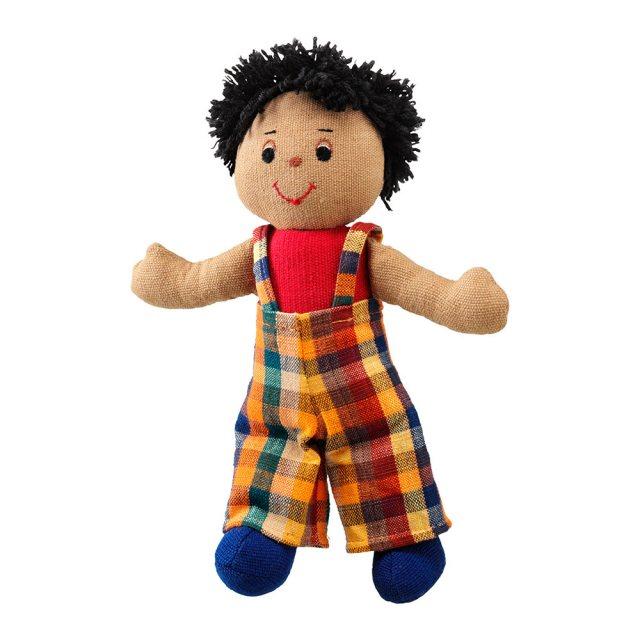 Soft toy boy rag doll with brown skin, black hair wearing multicoloured dungarees