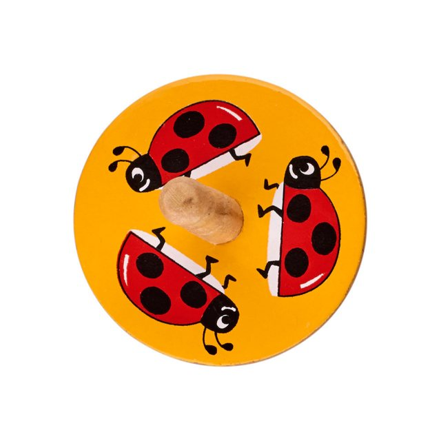 a birds eye view of a yellow spinning top with a design of three red ladybirds