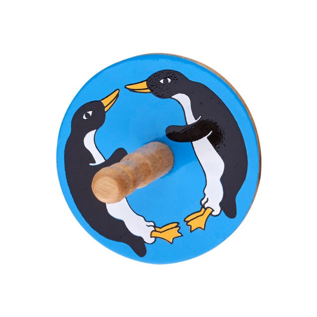 birds eye view of a blue spinning top with a design of a two penguins