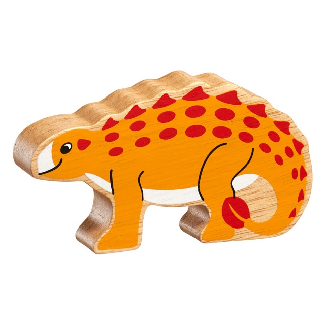 A chunky wooden yellow saichania dinosaur toy figure in profile with a natural wood edge