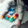Child playing with selection of Lanka Kade jigsaw puzzles