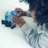 Child playing with blue train jigsaw puzzle