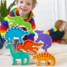 Set of six colourful wooden dinosaurs stacked in a tower by a toddler
