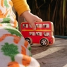 Child playing with selection of Lanka Kade double decker bus