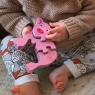 Child playing with the four piece pink pig and piglet wooden jigsaw puzzle
