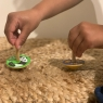 Child playing with selection of Lanka Kade spinning tops