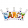 Small, flat wooden name plaque in white crown design with Darcy spelt in multicoloured letters
