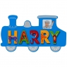 Small, flat wooden name plaque in blue train design with Harry spelt in multicoloured letters