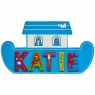 Small, flat wooden name plaque in blue Noah's ark boat design with Katie spelt in multicoloured lett