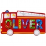 Small, flat wooden name plaque in red fire engine design with Oliver spelt in multicoloured letters