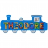 Large, flat wooden name plaque in blue train design with Theodore spelt in multicoloured letters