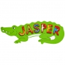 Large, flat wooden name plaque in green crocodile design with Jasper spelt in red letters