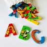 Set of 26 wooden letters in different colours with a calico storage bag