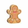 A chunky wooden gingerbread man toy figure in profile with a natural wood edge
